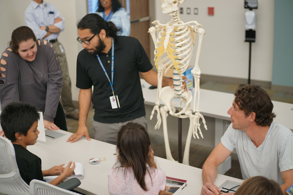 Pamela Brearey, Arnulfo Duarte, and Patrick Henke teaching the bones of the body.
