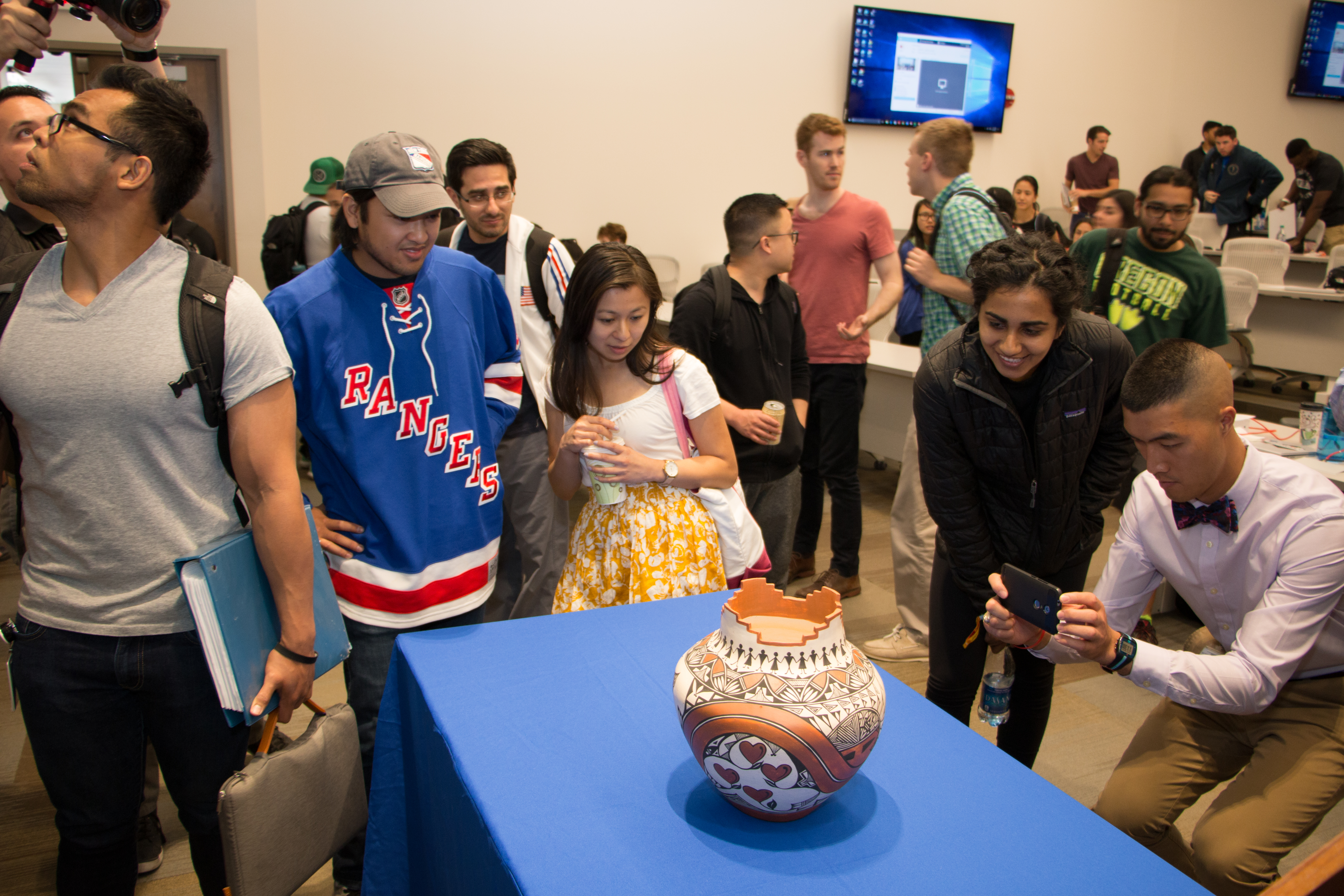 Students examine the finished pot.