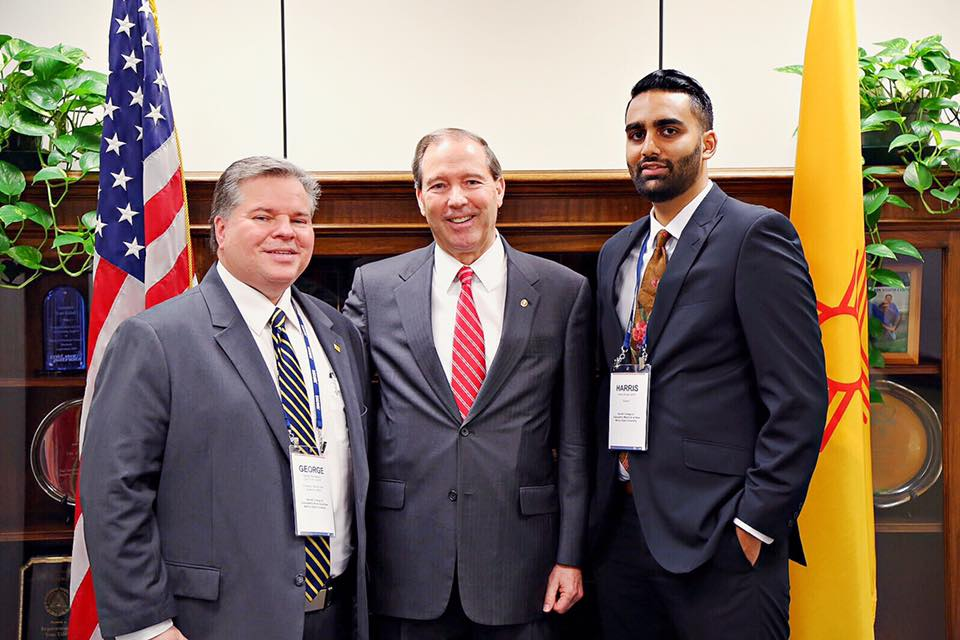 Dean Mycahskiw, Senator Tom Udall, and BCOM Student Harris Ahmed