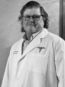 Greyscale portait of Dr. Eric Peterson